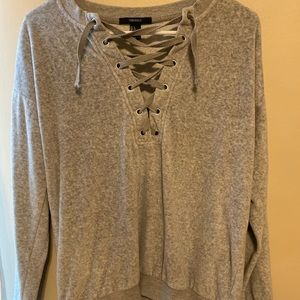 plush, gray sweater with front crossover